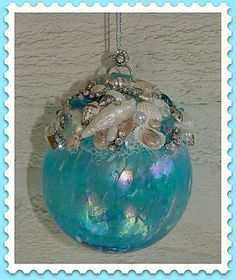 Aqua glass and seashell ornament. I can think of some changes that would work awesome! Coastal Christmas Decor, Nautical Christmas, Tropical Christmas, Handmade Christmas, Beach Christmas, Purple Christmas, Christmas Tables, Diy Christmas, Seashell Projects