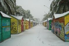 snow covered wooden colouful store bungalows in San Benedetto del Tronto, marche region, Italy