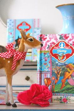 plush deer and blue colorful books by pip studio