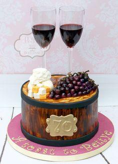 Wine barrel cake!  #winebarrelcake #winecake #wineandcheesecake #cheeseandwinecake #winecake #barrelcake #cheeseandgrapescake #wineandgrapescake #fondantgrapes #fondantgrapecake #glassofwinecake #peggydoescake
