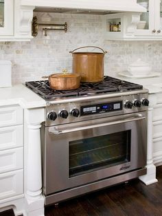 Dual-Fuel Range a MUST have. And i love the backsplash.