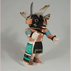 "Hopi Chaveyo - Black Ogre Katsina Doll. Carver Unknown      Category: Traditional     Origin: Hopi Pueblo     Medium: wood, paint, hair, feathers, cotton     Size: 9-1/4"" tall     Item # 25833"