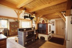 Though this Timber Frame home sports a fully modern kitchen, the heart of this home is the Bavarian styled masonry heater and wood cook stove.