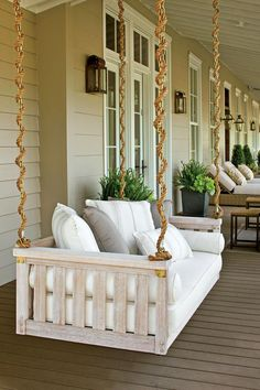 The Porch Swing - Your Favorite Pins of 2016 - Southernliving. The entrance to our Nashville idea house is full of Southern design inspiration. This porch swing is just inviting people to come and sit-a-spell.  See the Pin.