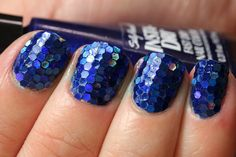 Wow I don't think I could ever do this, but it's so pretty!  Mermaid scale nails!