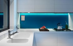 All white kitchen and blue splashback. By Alexander Lotersztain and derlot, Brisbane.
