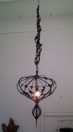 Hand forged metal chandelier. Could be fabricated to your size preference.  $6,000. - $12,000