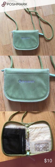 Sherpani small organizer Sage green, good shape. Crossbody, great for travel. Sherpani Bags Crossbody Bags