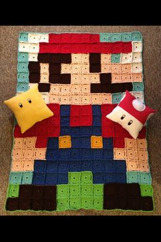 Mario crocheted blanket that I crocheted for my daughter. The fleece pillows were hot glued, no sew!