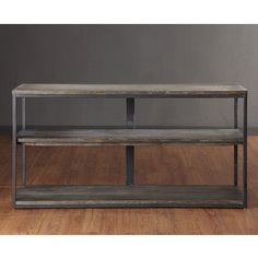 Add style, color, and drama to your home with this Renate entertainment console. A hand-crafted reclaimed wood finish combines with two fixed shelves to complete the design of this media console.