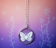A tiny little handcut paper butterfly is housed between 2 micro-thin pieces of glass.  Ready to wear papercut jewelry! By Sarah Trumbauer Available for sale on Etsy