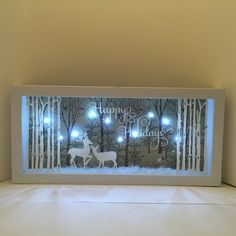 A personal favorite from my Etsy shop https://www.etsy.com/listing/484150027/christmas-shadow-box-lighted-shadow-box