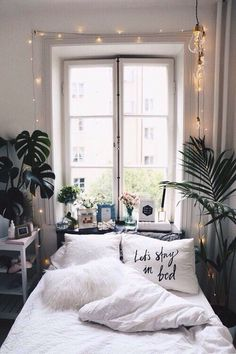 Ideal bohemian bedroom set up for a small bedroom. Love the combination of house plants and fairy lights.