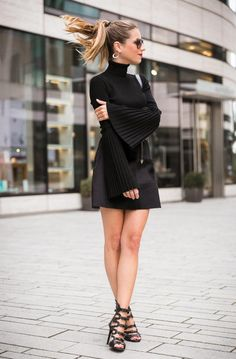 Outfit woman Statement sleeves all black turtleneck pullover, Chanel boy bag & heels