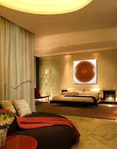 The circular designs just above the bed and on the ceiling make this room absolutely unique.
