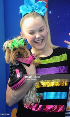 Dancer JoJo Siwa and dog BoBo arrive for the premiere of Warner Bros. Pictures' 'Paddington 2' held at Regency Village Theatre on January 6, 2018 in Westwood, California.