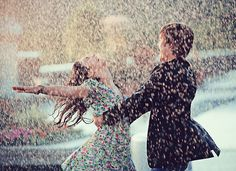 LOVE. ADORABLE!! i can't tell if it's rain or like confetti or something but i like it and think it'd make a great engagement or even wedding day pic