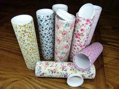 Estuches de tubos de cartón(reciclado)forrados en tela.