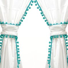 Cotton curtain panel with turquoise pompom trim. Inspiration for DIY nursery curtains. Use pink or blue