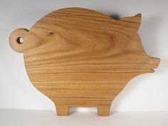 Large pig shaped canarywood cutting board