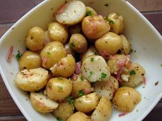 Eat potatoes chilled. When potatoes are cooked, their starch cells swell and start to break down — a process known as gelatinisation. This allows them to be digested more easily. But when potatoes are chilled after cooking, some of the gelatinised starch is converted into a more solid, crystalline form of starch that can't be digested, called resistant starch. This resistant starch, like fibre, ends up in the large intestine, where it's thought to help improve regularity.