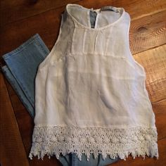 Sleeveless Cotton Tee with Lace Trim Sleeveless Cotton Tee with Lace Trim. Only worn once or twice. Looks great with jeans or shorts. Go to summer top! Chloe K Tops