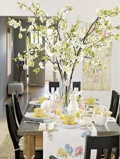 I think what I like most about this table top is the large scale of the Easter Tree out of budding branches.  Really makes an impact and would last forever - just remove the eggs after Easter and scatter the branches into a smaller vase for the entry way table and one for the fireplace (or two if you're into symmetry)
