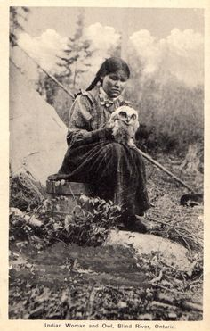 Indian woman and owl, Blind River, Ontario, c. 1910.