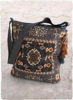 Viennese Bag  Designed after a vintage Austrian rug, our bag is handcrocheted of pima cotton, with a long shoulder strap and tasseled trim; fully lined.