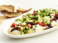 Healthified Greek Layered Dip - 70% less fat • 54% fewer calories • 48% less sodium than the original recipe. Youll love this much better-for-you appetizer updated with fat-free ingredients, extra veggies and baked whole wheat pita chips / BettyCrocker.com