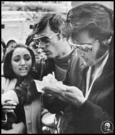Elvis signing an autograph for young Madonna