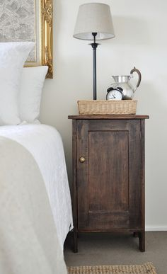Use the wicket basket on the bedside table.  Love this little antique looking beside table too.