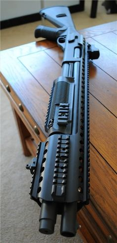 weaponslover: gunrunnerhell: Remington 870 Being one of the most popular pump-action shotgun models on the market, the 870 has its share of aftermarket parts. This particular example has the Mesa Tactical Urbino stock, which mimics the Benelli M4. It also has the Harris Tactical Full Rail System installed. Although it looks heavy, the rail according to Harris Tactical's website only weighs about 1 pound. It doesn't sound like much but given the amount of rails, it would be easy to go ...