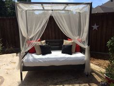 Outdoor Daybed by Ana White. Made by jewels.  I wanted a Daybed so I could relax outside and read. I found this bed plan on Ana's. I use a blowup camping mattress and twin bed mosquito canopy netting!  Love love, my bed.