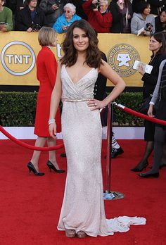 Brides.com: The Most Wedding-Worthy Red Carpet Dresses. Lea Michele at the 2011 SAG Awards. Michele rocks a thoroughly modern, glamorous bridal look in her belted Oscar de la Renta gown, which is perfectly complemented by her short, tousled waves and elegant bangles.  Browse Oscar de la Renta wedding dresses.
