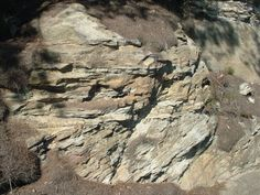 This photograph of a classic unconformity was taken at a road cut at Berowra,New South Wales, Australia. An unconformity is a geological structure that's significant because it represents a time during which no sediments were preserved in a region. Because the local record for that time interval is missing, geologists must use other clues to discover the part of the geologic history that's absent. The interval of geologic time not represented is called a hiatus. An unconformity is often a…