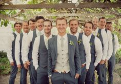 Blue grey suit with a silver vest for the groom and blue grey vests for the groomsmen.