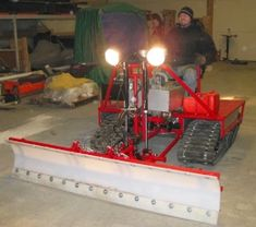 Snow Dozer - Homemade Miller snow dozer constructed from a Kohler 17hp 2-cylinder engine, snowmobile tracks, and hydrostatic transaxles from a zero-turn lawnmower.
