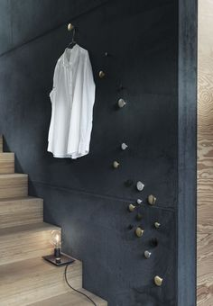 Decorate and create smart storage in your entryway with these pretty metallic hooks by Muuto.