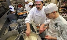 Chef instructor Greg Atkinson tests a student's sauce at Seattle Culinary Academy.