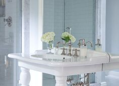 Gorgeous Blue And White Bathroom Features Blue Walls Framing A Full Length  Mirror Positioned Behind A