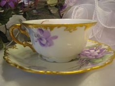 """FRENCH AFRICAN PURPLE VIOLETS TEA CUP & SAUCER"" Antique Limoges from oldbeginningsantiques on Ruby Lane"