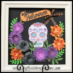 Halloween artwork for my shadow box. Used Flower Market for all the cuts and the sugar skull. www.craftysisterscreations.com