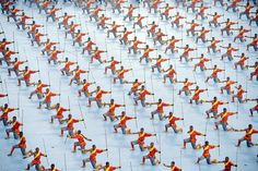 ENTER THE DRAGON: Students from a martial-arts school performed at the opening ceremony of the ninth Shaolin International Martial-Arts Festival in Zhengzhou, Henan province, China, Sunday. Shaolin Kung Fu, Zhengzhou, Enter The Dragon, Qigong, Wall Street Journal, Art Festival, Chinese Art, Karate, Martial Arts