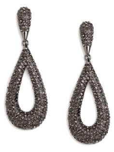 Calling all discotheque darlings! With its allover glittering black crystals and flirty teardrop silhouette, this jet-set statement style is made for you.