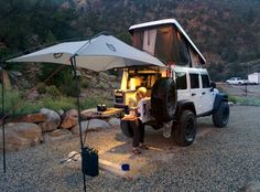 Jeep becomes base camp with awning and pop up roof Jeep Wrangler Camper, Jeep Wrangler Rubicon, Jeep Jk, Jeep Truck, Jeep Wrangler Unlimited, Jeep Wrangler Interior, Accessoires De Jeep Wrangler, Jeep Wrangler Accessories, Jeep Accessories