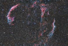 APOD 11/26/12 Wisps of the Veil Nebula - Wisps like this are all that remain visible of a Milky Way star. About 9,000 years ago that star exploded in a supernova leaving the Veil Nebula, also known as the Cygnus Loop. At the time, the expanding cloud was likely as bright as a crescent Moon, remaining visible for weeks to people living at the dawn of recorded history. Today, the resulting supernova remnant has faded