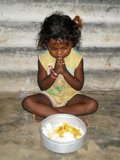 Amma Irene Feeding Program, India. Gypsy child praying before a meal.
