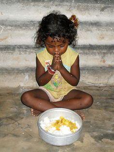 Amma Irene Feeding Program, India. Gypsy child praying before a meal.
