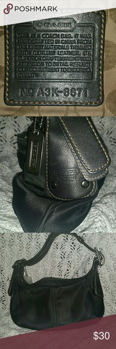 "Coach 6671 Small Black Hobo Handbag RARE...  Small Black Nylon, canvas, leather trim Hobo Handbag.   Creed Serial number A3K-6671 (90's vintage)  Measures 11"" x 5.5"" with adjustable leather shoulder strap.  Excellent condition.  No stains, marks, or  tares Coach Bags Hobos"
